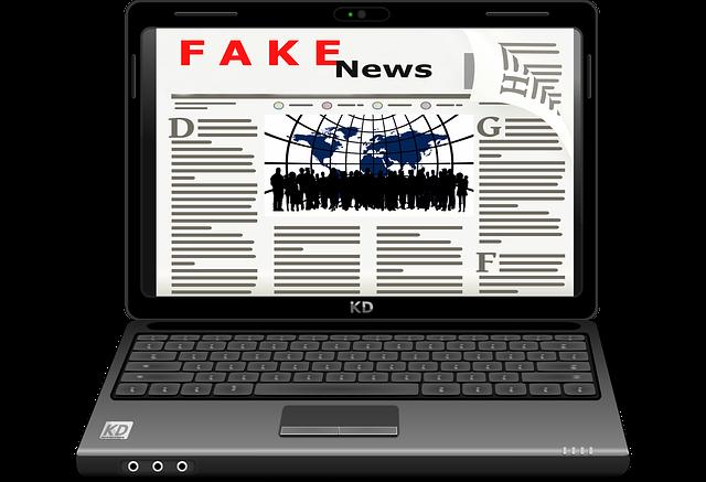 laptop s webem novin